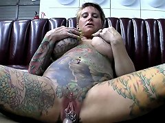 A Wild Chick Covered In Tats With Many Pussy Piercings Fucks